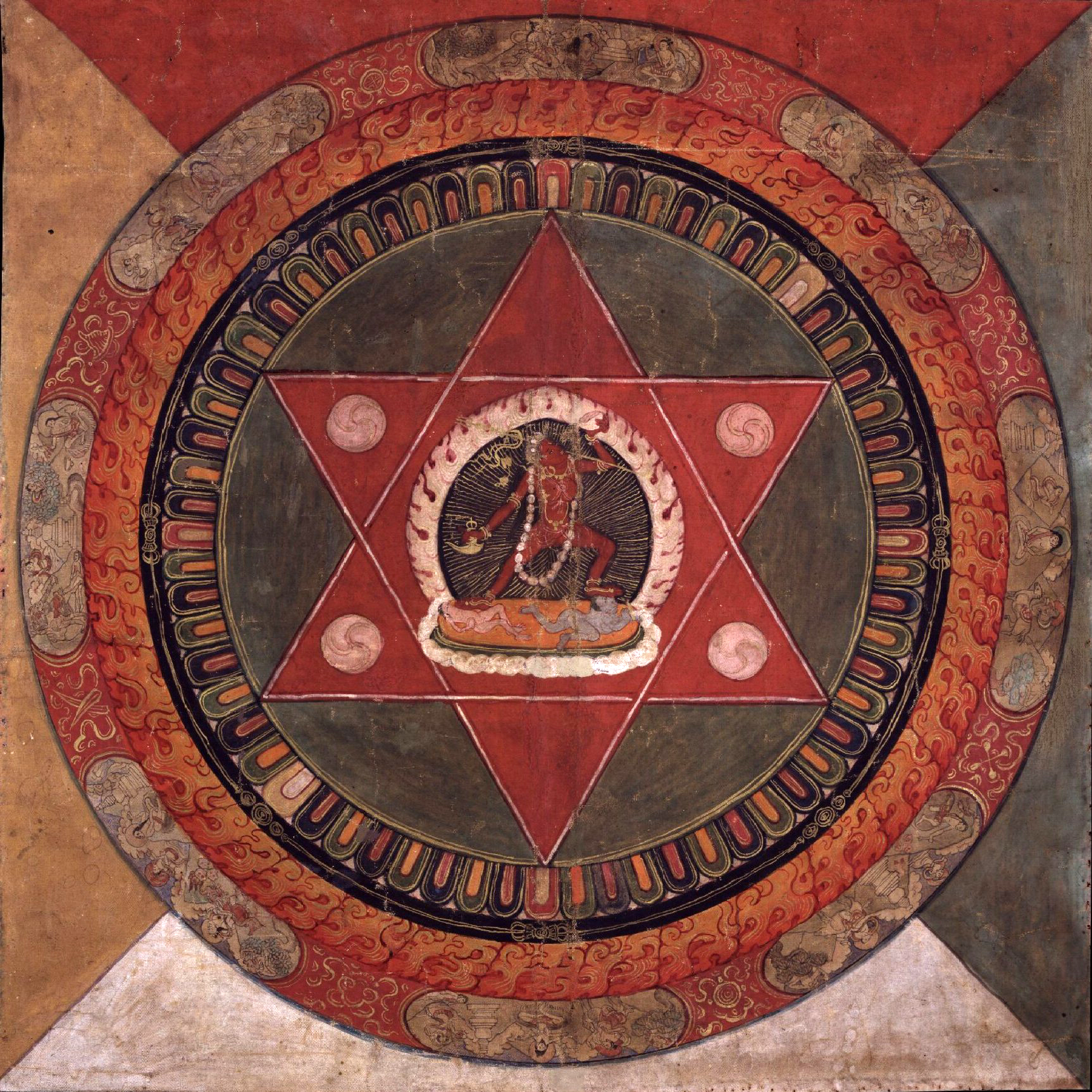 Painted_19th_century_Tibetan_mandala_of_the_Naropa_tradition,_Vajrayogini_stands_in_the_center_of_two_crossed_red_triangles,_Rubin_Museum_of_Art